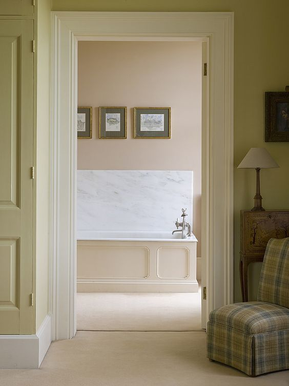 Farrow and Ball Setting Plaster pink paint color on wall in classic luxurious bathroom.