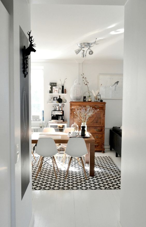 A small dinette set on a 5'x7' rug creates a lovely and functional dining area in a small apartment.  A small cabinet can hold plates, napkins, placemats and serving dishes.  The top of the cabinet can be used as a side board for serving.