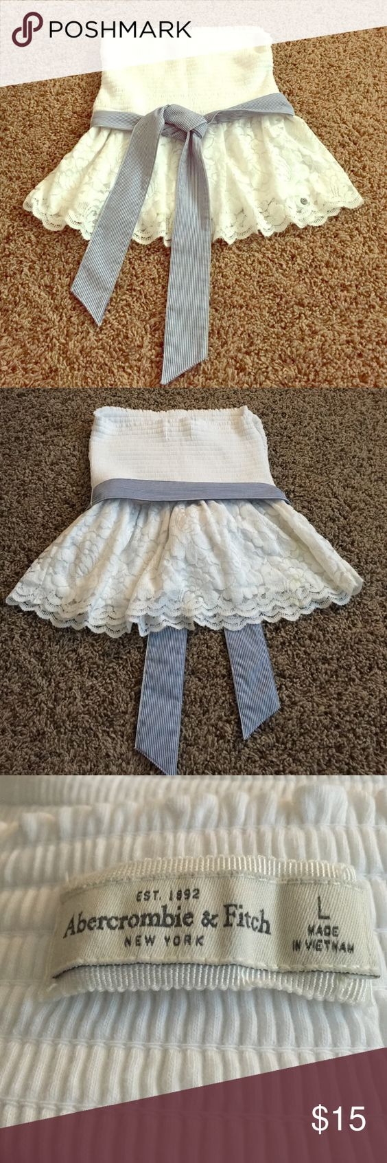 """Abercrombie & Fitch White Strapless Top Large Abercrombie & Fitch White Strapless Top Large. Very stretchy and super cute!  This is more like a juniors large see measurements. 12"""" Unstretched across chest and 17"""" long. Abercrombie & Fitch Tops Blouses"""