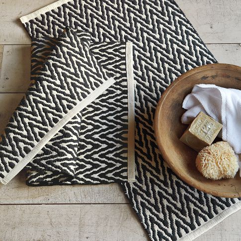 West Elm bath mat. Use this gorgeous chevron soft underfoot mat at the back door to protect carpet when the kids come in from the garden area.