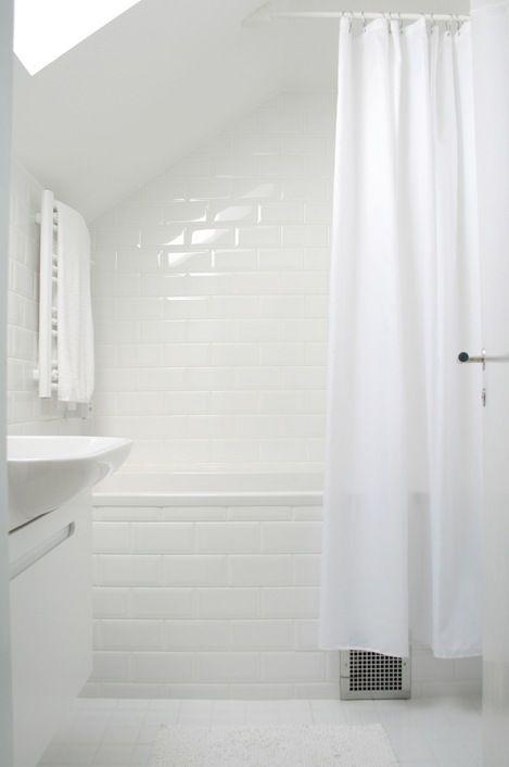 Gorgeous white bathroom at Chez Larsson