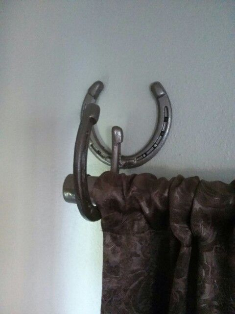 I think I might have Rich make me a pair of these.  Another way to use up our pile of horse shoes.
