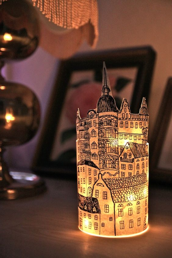 handmade paper lantern drawn on wallpaper and wrapped around a glass jar. i love the cityscape!