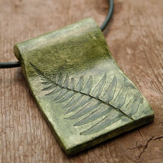Clay Pendant Fern Leaf Impression - Hand-sculpted Clay Pendant with Moss Colored Acrylic Finish. $20.00, via Etsy.
