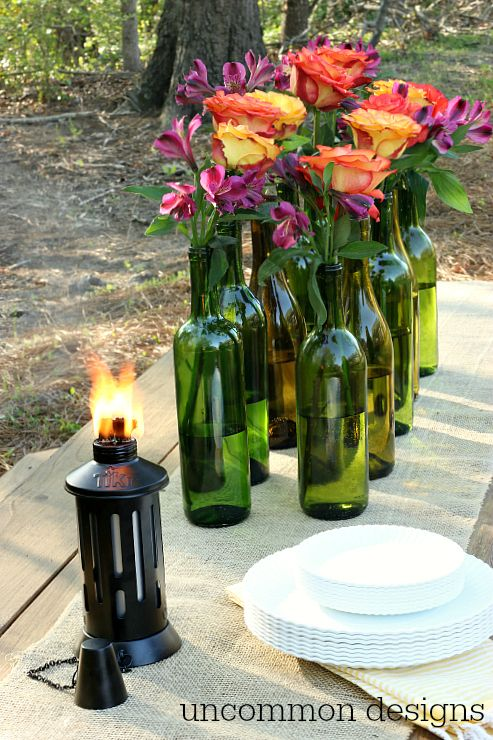 Wine bottles bottle and wine on pinterest for Outdoor decorating with wine bottles