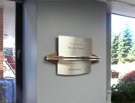 Stainless Steel Campaign Donor Plaque: A set of plaques were created to coordinate with the doctors donor wall. High level individual donors were recognized with a stainless steel plaque mounted to a wood bracket.