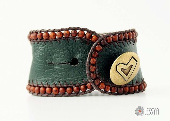 This is a genuine leather original boho bracelet/cuff, that has a row of brown magnisite beads along the edge and it closes up with a vintage brass