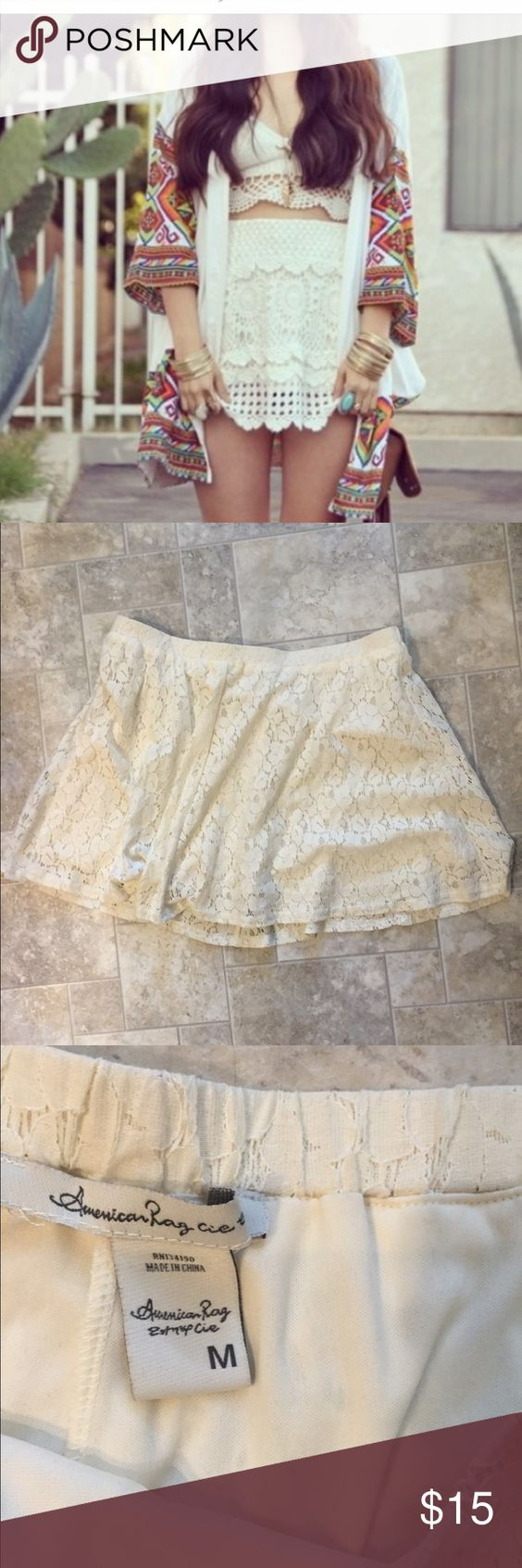 Lace mini skirt In great condition. Fits more like a Large American Rag Skirts Mini
