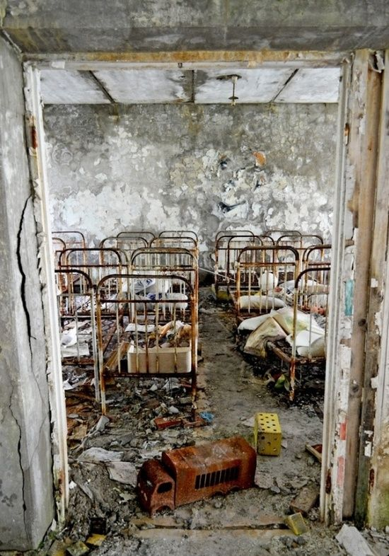 Cots in the former nursery in the abandoned town of Prypiat, Ukraine near the…