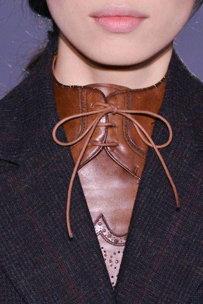 DJ4: This collar imitates an Oxford shoe. Since the fabric appears to be as thick as leather, I can only imagine this to be a bib, rather than a garment. The crisp look of this collar adds sophistication to the garment.