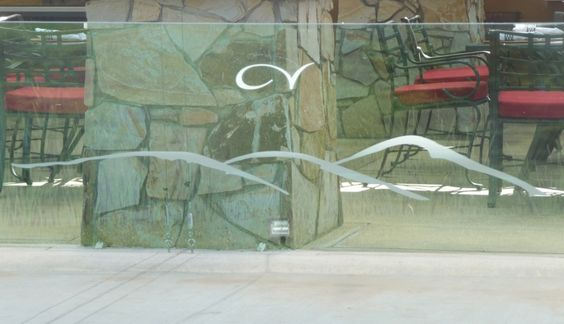 Etched film logo on glass, raised from wall
