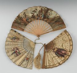 """Three Victorian Hand Fans     8-1/2""""L, 8-5/8""""L, 8""""L  The first with carved, pierced bone sticks decorated in gilt and silver pigment, apprx. 8-1/2""""L, with pictorial chromolithograph paper fan and gilt design on the paper back. This one has some separation of the paper on one side. The second fan also pictorial with an idyllic scene in chromolithograph on paper and plain paper back, carved and pierced bone sticks, silk tassel, apprx. 8-5/8""""L. The last a very perishable souvenir paper fan with…"""