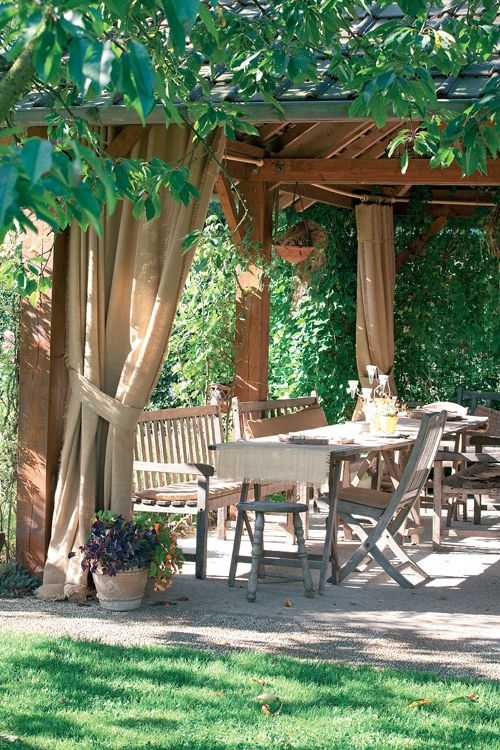 Pergola with canvas curtains- this is what I want but with screens instead of canvas