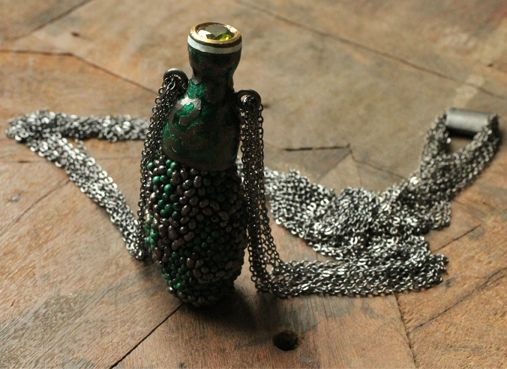 Esther Brinkmann, Untitled. Pendant, 2014. Enamel on Oxidized SIlver, Peridot, Embroidery with malachite Pearls and River Pearls, Oxidized Silverchain. Box: Bamboo, Silk. Photo (C) Chemould Prescott Road