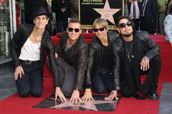 "Truly an ""Irresistible Force."" Jane's Addiction's Perry Farrell, Stephen Perkins, Chris Chaney, and Dave Navarro receive a star on the Hollywood Walk of Fame on Oct. 30 in Hollywood, Calif."