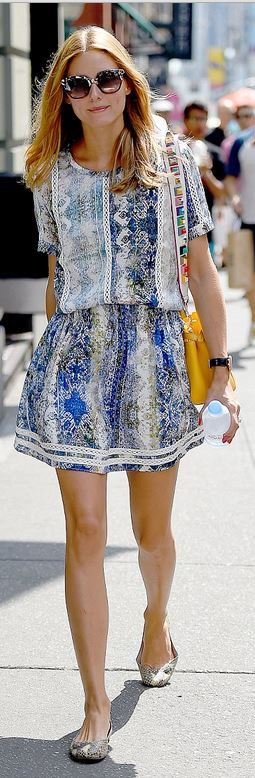 Who made  Olivia Palermo's yellow handbag, snake ballet flat shoes, cat sunglasses, and blue print short sleeve dress?: