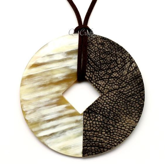 """A beautiful pendant handmade from buffalo horn and ostrich leather. High polish finish. Lightweight. Actual colors may vary. 3.15"""" (8cm) diameter."""
