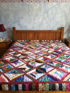 made by Liz Morrison Dempsey, Owner of Blueberry Cove LongArm Quilting Studio...   Scrappy quilt all finished just needs its label
