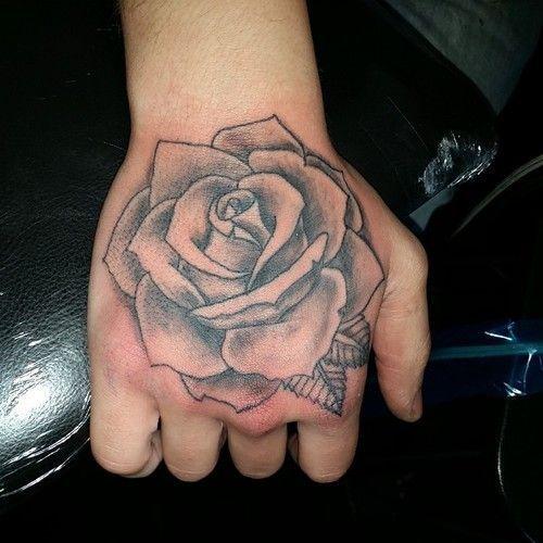 Grey Rose Tattoo On Right Hand Tattoomenarm Rose Hand Tattoo Hand Tattoos Rose Tattoos For Men