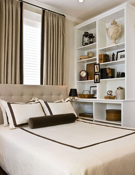 I love the shelves going up to the ceiling using vertical for Utilizing space in a small bedroom