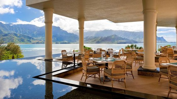 The St. Regis Princeville Resort is set against a backdrop of lush sea cliffs over Kauai's Hanalei Bay. Book the Royal Suite for 2,400 square feet of private luxury with exquisite views.
