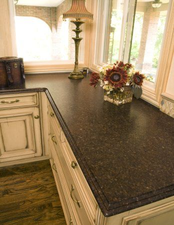 Cream cabinets granite and cabinets on pinterest for Cream colored granite countertops