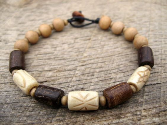 Mens bracelet, carved bone and wood beads, surfer style, natural materials, on strong cord, toggle and loop clasp, earthy, tribal by thehappymushroom on Etsy https://www.etsy.com/listing/196809406/mens-bracelet-carved-bone-and-wood-beads