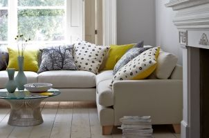 Grey.splashes.mustard.colour.cream.traditional.corner.sofa.fireplaces.natural.wood.floor