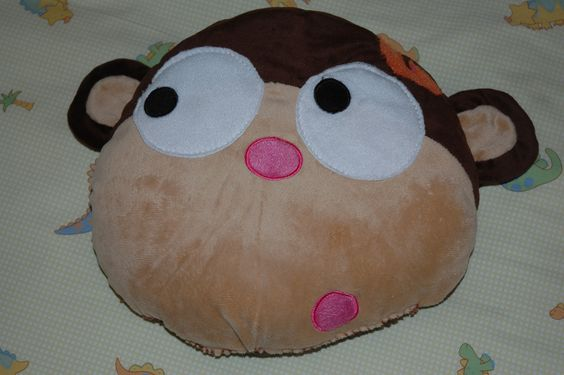 """Weighted Sensory Pillow I made...  Bought a pre-made pillow, cut open the bottom seam,took out half the stuffing. Patted down the rest, added 2 lbs. Poly Pellets... Re-stitched seam.    Monkey also had a felt pink flower above the ear- I removed it & sewed an orange """"G"""" onto the spot."""