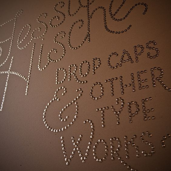 Clever idea using Thumbtacks. I'm thinking a monogram on the wall?