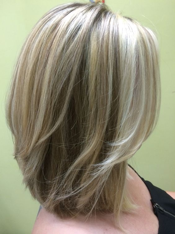 three shades of blonde shoulder length layered bob hair