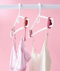 slip rubber bands onto the edges of  hangers to keep clothes from sliding off