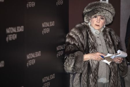 Gossip columnist Liz Smith works on the red carpet at the National Board of Review gala in the Manhattan borough of New York