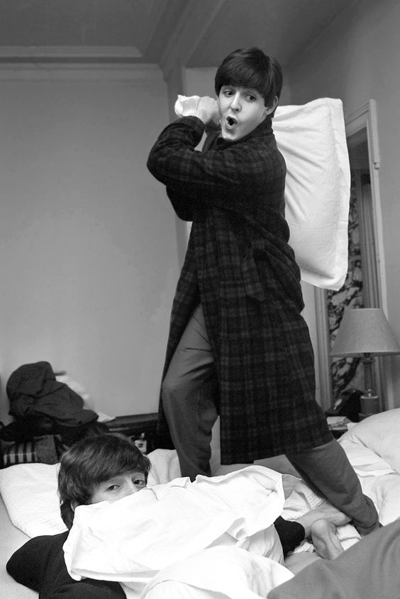 John Lennon and Paul McCartney at the George V in 1964. [Photo by Harry Benson]