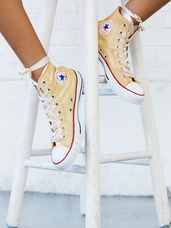 Dance Moves Hi Top Chucks | With a lived-in look featuring so pretty details, classic kicks get an ultra femme update. These Converse canvas high-tops are specially washed in NYC and topped off with an ultra femme ribbon in place of traditional laces, creating your most unique sneaker.