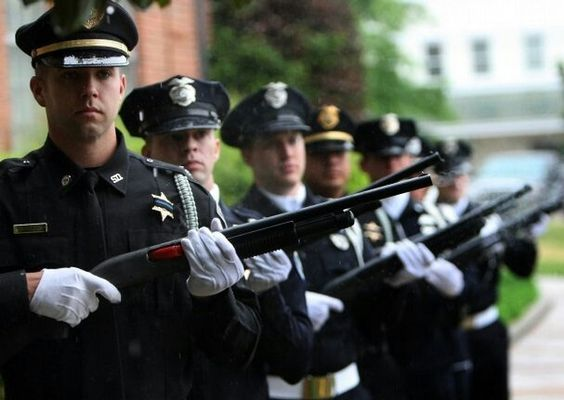 2nd from left.  At a funeral detail for a fallen officer