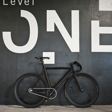 :: DETAILS :: oversized text layered on a black wall and delightful a black on black bike, a bit to chunky for me but i like the layering of this image #details