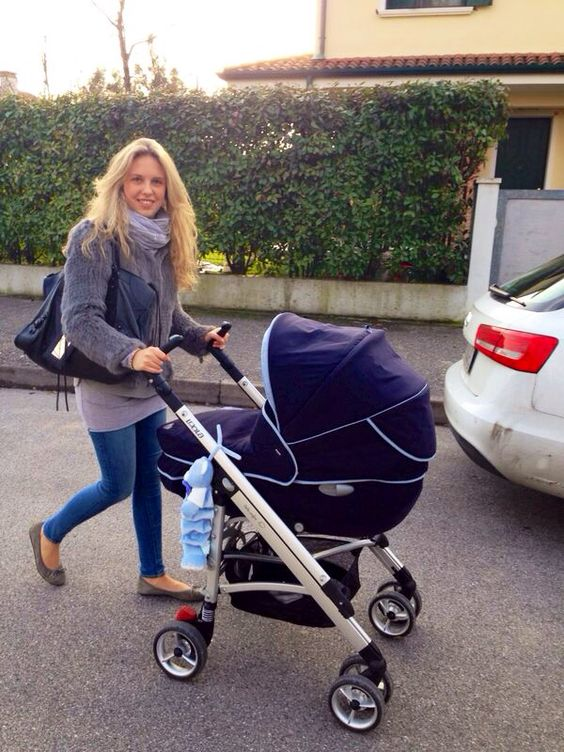 Giorgia Marin walking in Rome with her new baby cousin.