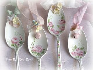 painted and ribboned up spoons w/bells and posies
