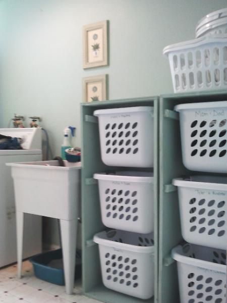 Great Laundry idea. Could also do different categories: kids clothes, work clothes, undergarments, sports wear, towels, etc. Also, considering hang a piece of fabric over the laundry bin holders so it looks nicer. Choose a nice fabric, use small nails or velcro to get it to stay up. Another user said use 4 tier plastic shelving, a shelf for each laundry basket.