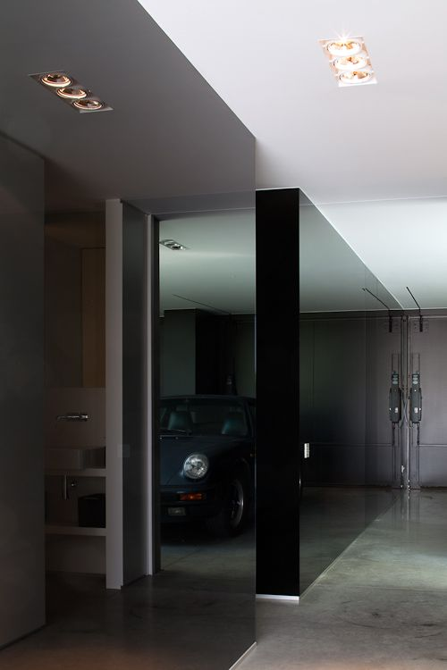 Private garage inside the belgian poolhouse by steven for Luxury garage interiors