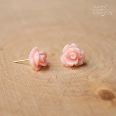 This dainty pair of rose flower studs are a beautiful pale shade of pink. They are made with acrylic flowers and hypoallergenic posts. They come with plastic comfort backs.
