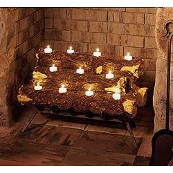 Candles In A Fireplace making a feature out of an empty fireplace: log tea light candle
