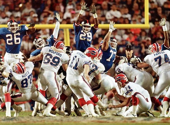 Super Bowl XX, Jan. 26, 1986  Jim McMahon  Chicago Bears quarterback Jim McMahon is upended on a scramble by the New England Patriots defense. McMahon became the first quarterback to rush for two touchdowns in a Super Bowl; he threw for 256 yards in the 46-10 rout.