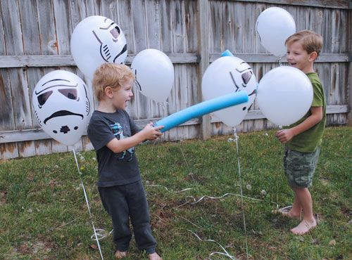 A fun game that the kids will love is battling the Storm Troopers with their own lightsabers.  You can create a pool noodle lightsaber and hang up Storm Trooper balloons and then the kids go to battle.