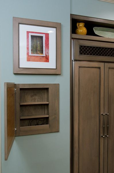 Hidden storage storage and wall stud on pinterest for Picture frame organization wall