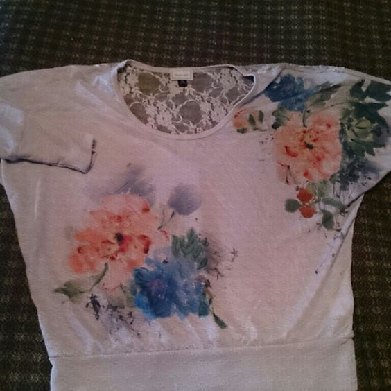 Beautiful flowery blouse with lace. Pretty blouse with flower design and lace on back neck area. Never worn, fitted in waist. About A Girl  Tops Blouses