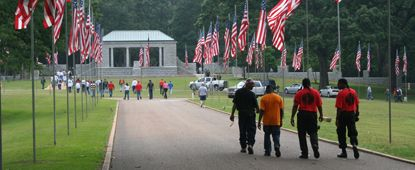 The avenue of flags leading the the rostrum in the National Cemetery during Memorial Day weekend.