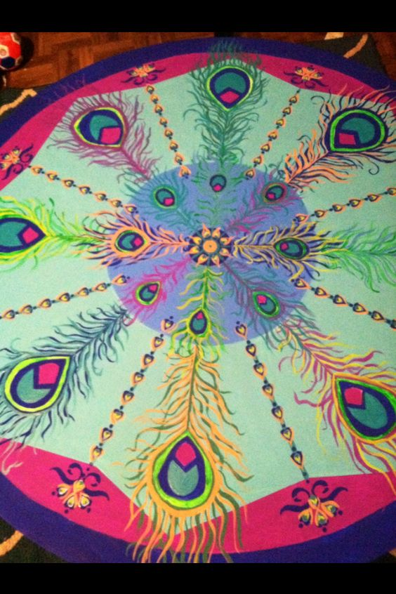My peacock mandala coffee table that I hand painted