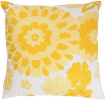 A sunny yellow pillow is the perfect pop of color for summer. HomeDecorators.com